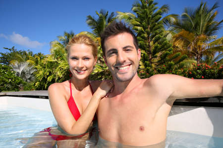 Cheerful couple relaxing in swimming pool photo