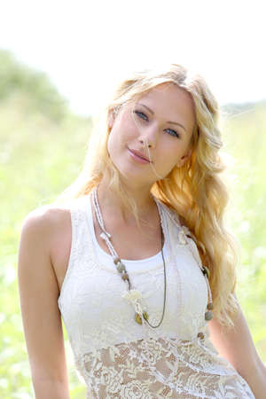 blonde  blue eyes: Portrait of attractive woman in countryside Stock Photo