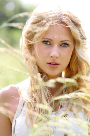 Beautiful blond girl in meadow  photo