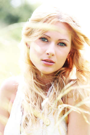 beautiful blonde woman: Beautiful blond girl in meadow