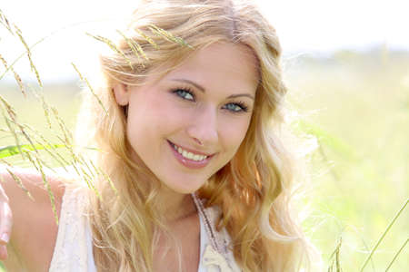Portrait of beautiful blond girl in countryside  photo