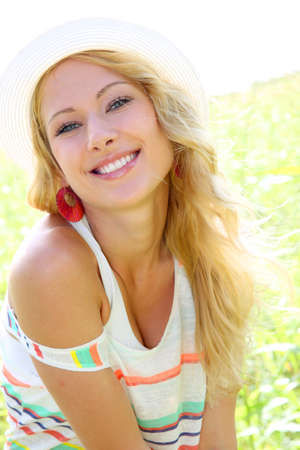 earings: Beautiful blond girl in countryside