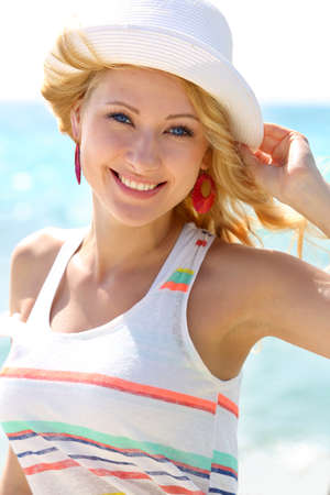 Closeup of beautiful girl at the beach photo