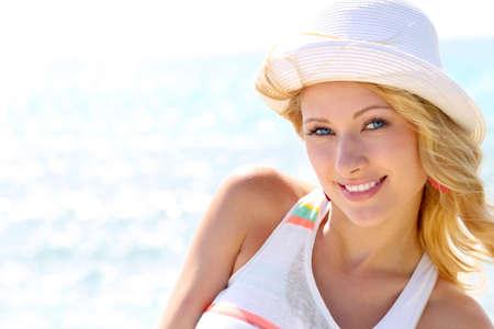 beach blond hair: Closeup of beautiful girl at the beach