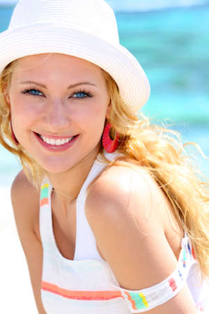 Cheerful girl in vacation at the beach photo