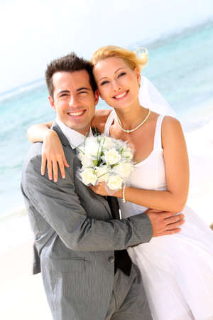 wedding beach: Cheerful married couple standing on the beach Stock Photo