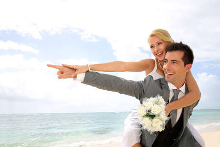 textspace: Honeymoon piggyback ride on the beach Stock Photo
