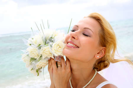 eyes shut: Portrait of beautiful bride with eyes shut by the beach