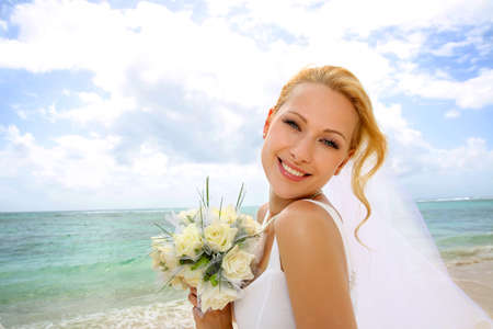 beautiful bride: Portrait of beautiful bride standing by the beach Stock Photo