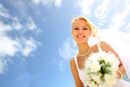 ring wedding: Portrait of beautiful bride with blue sky in background