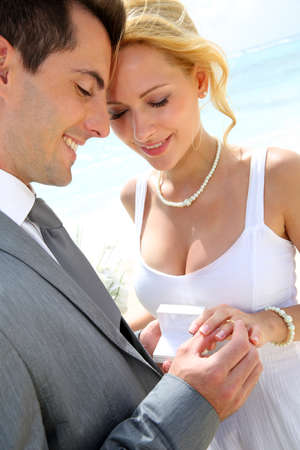 the happy bride: Bride and groom exchanging wedding rings  Stock Photo