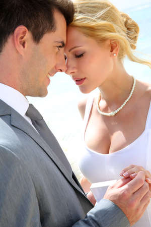exchanging: Bride and groom exchanging wedding rings  Stock Photo