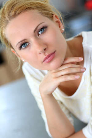 tied girl: Portrait of beautiful blond woman with hand on chin