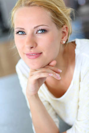 hair tied: Portrait of beautiful blond woman with hand on chin