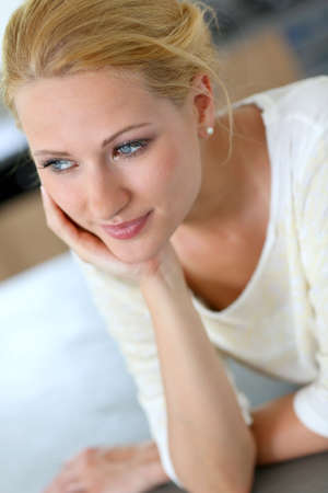 Portrait of beautiful blond woman with hand on chin photo