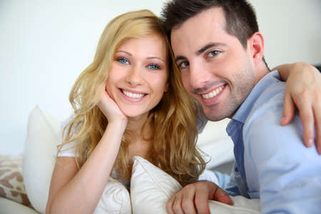 Cheerful in love couple at home photo
