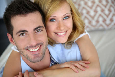 Portrait of cheerful in love couple at home photo