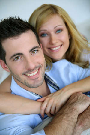 blonde  blue eyes: Cheerful in love couple at home