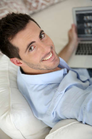 Upper view of young man using laptop computer at home Stock Photo - 17183993