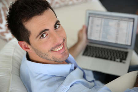 Upper view of young man using laptop computer at home Stock Photo - 17184102