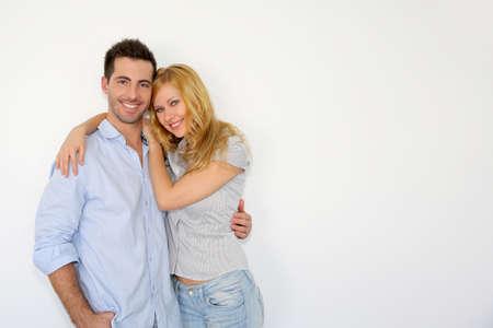 happy couple white background: Sweet couple embracing on white background