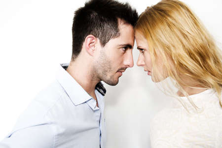 facing: Couple on white background touching foreheads Stock Photo