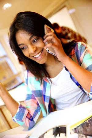 palmtop: Student girl using smartphone in class