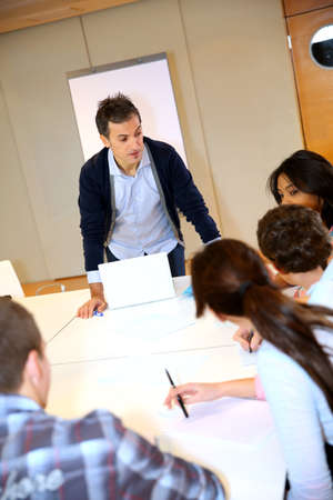 apprenticeship: College teacher in class with group of students Stock Photo
