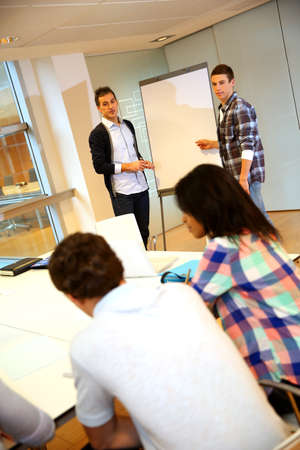 workmates: College teacher in class with group of students Stock Photo