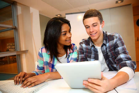 science class: Teenagers in class using electronic tablet Stock Photo