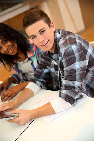an old friend: Teenagers in class using electronic tablet Stock Photo