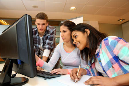 Group of students working in computer lab photo