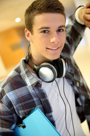 boy: Trendy young student boy with music headphones