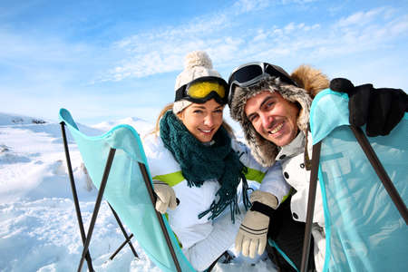 Portrait of skiers sitting in long chairs Stock Photo - 17801753