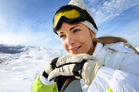 ski mask: Portrait of cheerful blond woman at ski resort