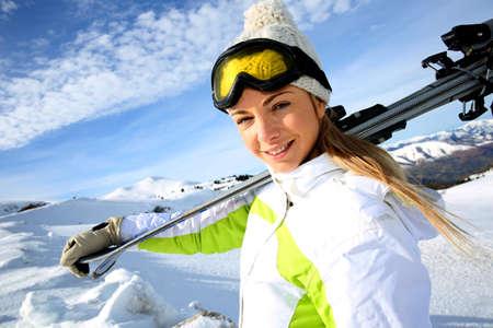 ski: Portrait of cheerful blond woman at ski resort