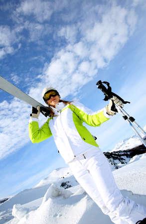 ski mask: Portrait woman skier standing on snowy mountain Stock Photo