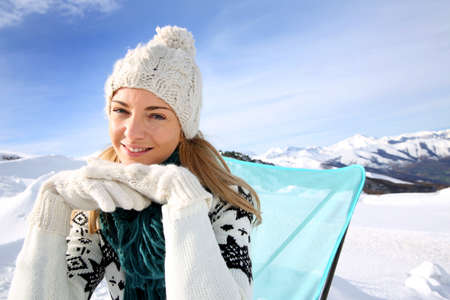 Portrait of beautiful woman in snowy mountain photo