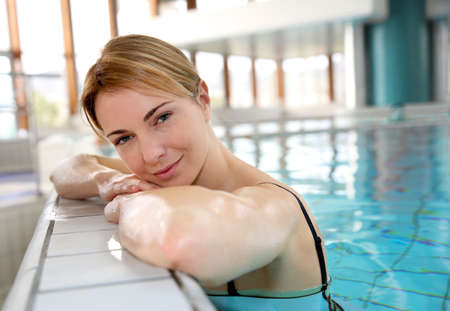thalasso: Blond woman relaxing in spa pool Stock Photo