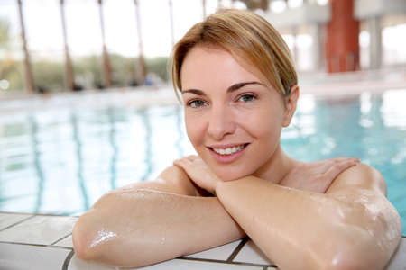 Blond woman relaxing in spa pool photo