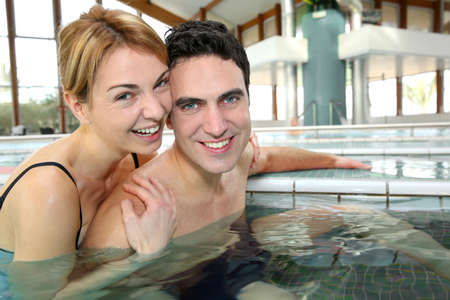 Couple enjoying bathtime in spa resort photo
