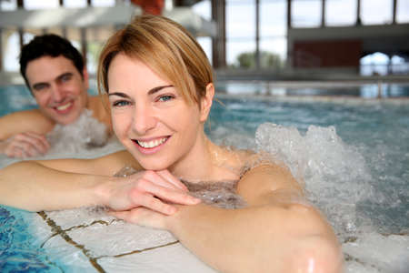jacuzzi: Portrait of woman with husband in jacuzzi