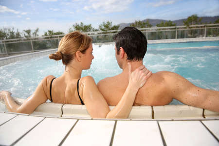 jacuzzi: Couple enjoying jacuzzi in spa center
