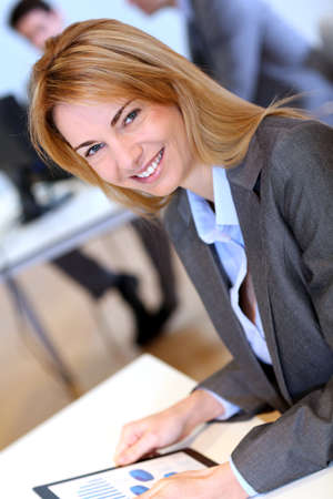 Businesswoman in office using electronic tablet Stock Photo - 17826717