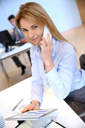Smiling businesswoman talking on mobilephone photo