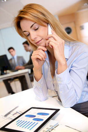 mobilephone: Smiling businesswoman talking on mobilephone Stock Photo