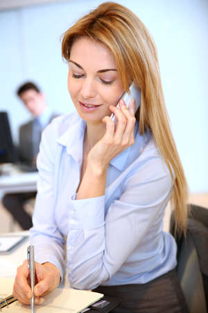 35 years old: Smiling businesswoman talking on mobilephone Stock Photo