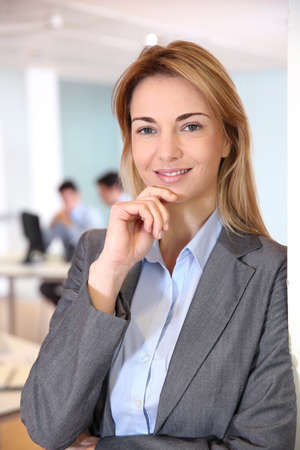 35 years old: Businesswoman standing in meeting room