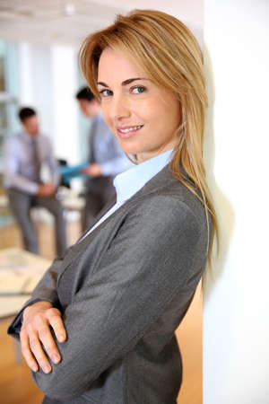 Beautiful blond businesswoman in meeting room photo