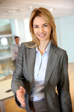 Businesswoman ready to give handshake  photo